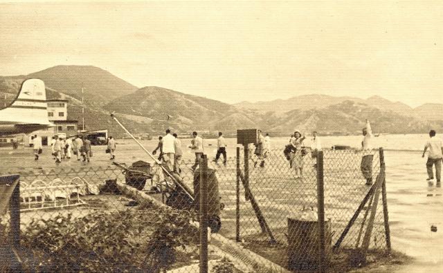 Luba Estes waves goodbye (right side) at Kai Tak airport, c. 1951